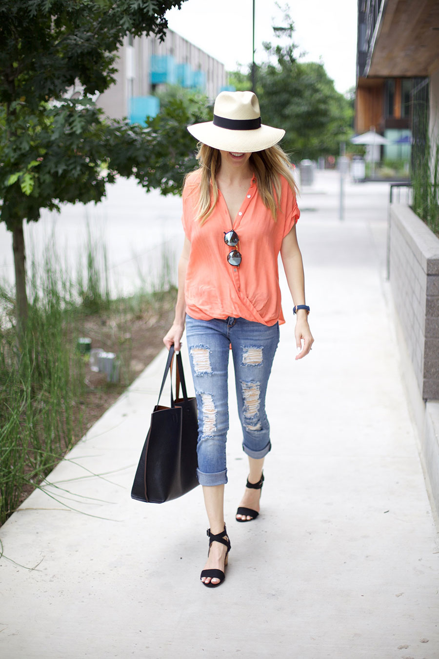 bright tee and distressed jeans