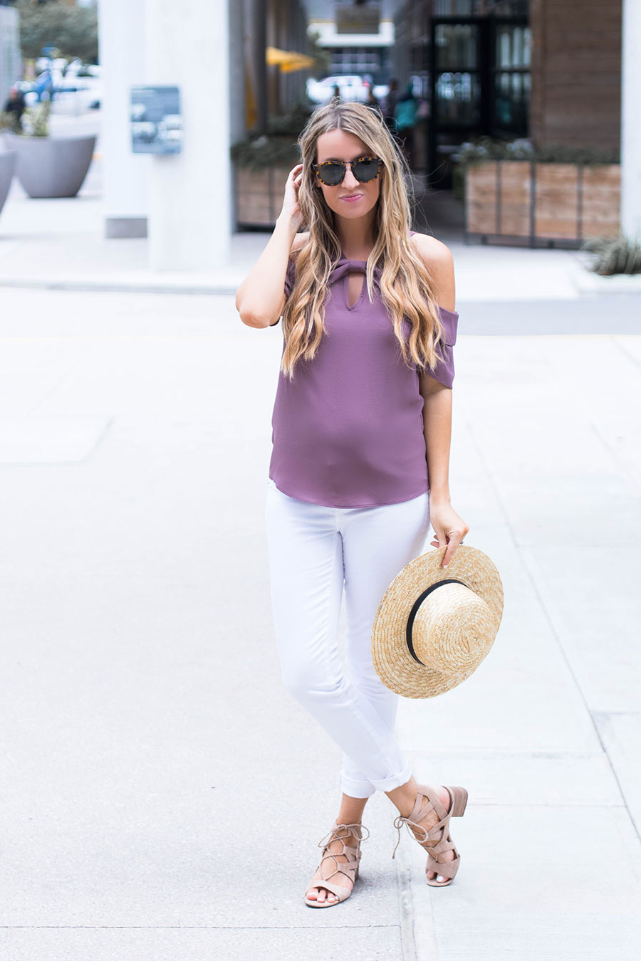 purple off the shoulder top and white jeans