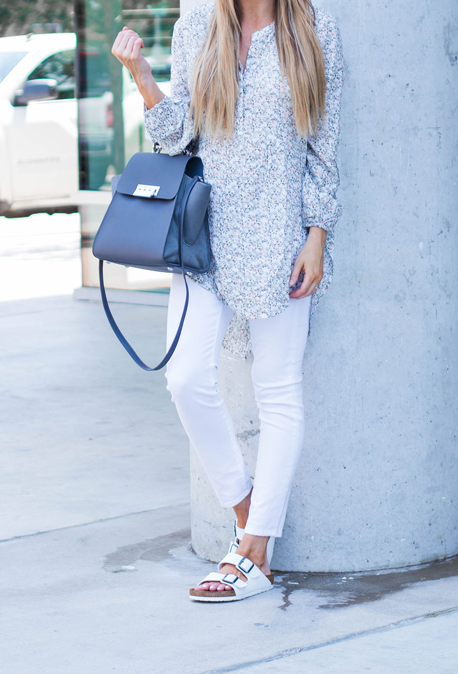 floral tunic and white jeans